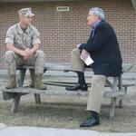 Dan Rather with U.S. Marine Corporal Yerandys Martell-Carrasco