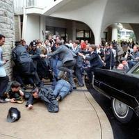 Photo of the assassination attempt on President Reagan. Dirck Halstead Photographic Archive, Dolph Briscoe Center for American History.